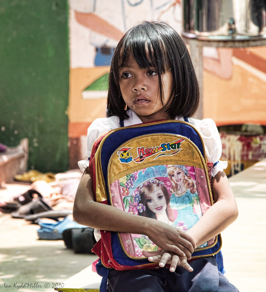 Little girl deep in thought at PIO School, Cambodia